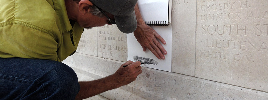 image of us rubbing a name in a WWI monument